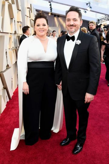 (L-R) Melissa McCarthy and Ben Falcone attend the 91st Annual Academy Awards on February 24, 2019 in Hollywood, California. (Photo by Kevork Djansezian/Getty Images)
