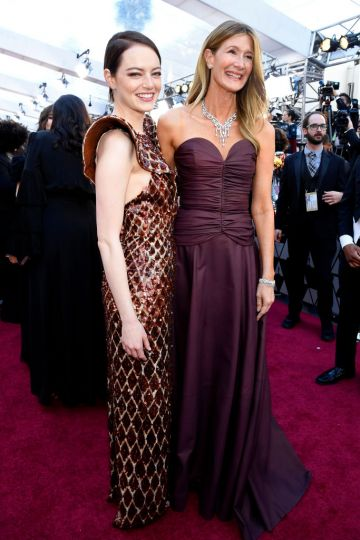 (L-R) Emma Stone and Laura Dern attend the 91st Annual Academy Awards on February 24, 2019 in Hollywood, California. (Photo by Kevork Djansezian/Getty Images)