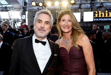 Director Alfonso Cuaron and Laura Dern attend the 91st Annual Academy Awards on February 24, 2019 in Hollywood, California. (Photo by Kevork Djansezian/Getty Images)