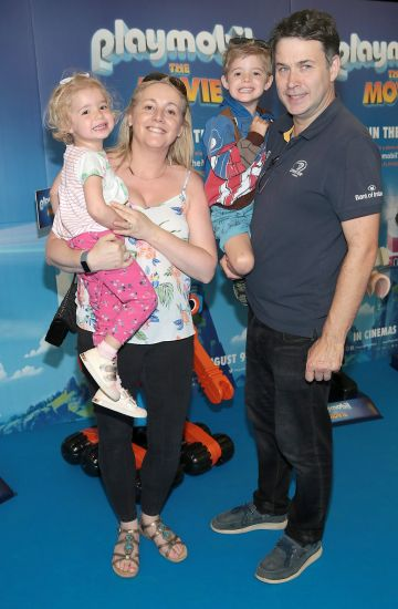 Nicky Cooke and Paul Cooke with children Hannah Cooke and John Cooke at the special preview screening of Playmobil : The Movie. Photo: Brian McEvoy