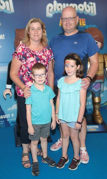 Donal Sullivan  and Annette Sullivan  with children Emily Sullivan and Eoghan Sullivan  at the special preview screening of Playmobil : The Movie. Photo: Brian McEvoy