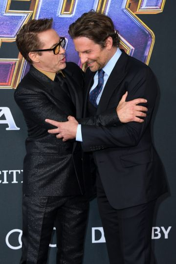 """US actors Robert Downey Jr. (L) and Bradley Cooper arrive for the World premiere of Marvel Studios' """"Avengers: Endgame"""" at the Los Angeles Convention Center on April 22, 2019 in Los Angeles. (Photo by VALERIE MACON/AFP/Getty Images)"""