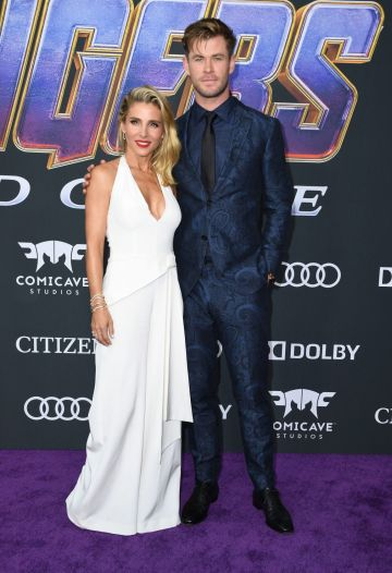 """Australian actor Chris Hemsworth and his wife Spanish actress Elsa Pataky arrive for the World premiere of Marvel Studios' """"Avengers: Endgame"""" at the Los Angeles Convention Center on April 22, 2019 in Los Angeles. (Photo by VALERIE MACON/AFP/Getty Images)"""
