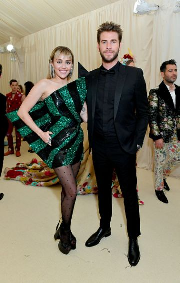 Miley Cyrus and Liam Hemsworth attend The 2019 Met Gala Celebrating Camp: Notes on Fashion at Metropolitan Museum of Art on May 06, 2019 in New York City. (Photo by Mike Coppola/MG19/Getty Images for The Met Museum/Vogue )