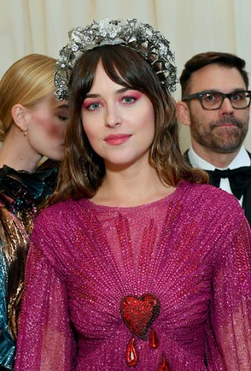 Dakota Johnson attends The 2019 Met Gala Celebrating Camp: Notes on Fashion at Metropolitan Museum of Art on May 06, 2019 in New York City. (Photo by Mike Coppola/MG19/Getty Images for The Met Museum/Vogue )