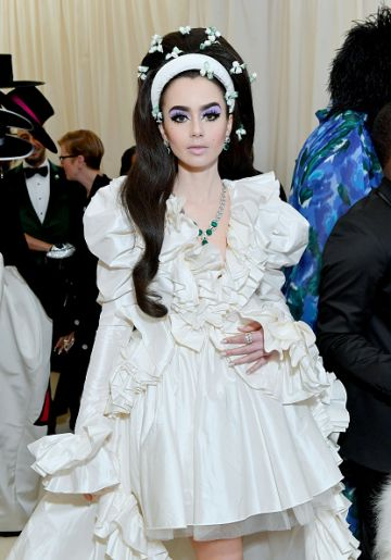 Lily Collins attends The 2019 Met Gala Celebrating Camp: Notes on Fashion at Metropolitan Museum of Art on May 06, 2019 in New York City. (Photo by Mike Coppola/MG19/Getty Images for The Met Museum/Vogue )