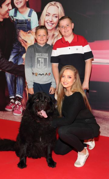 James McDermott, Ryan McDermott and Lara McDermott with Macy at the special preview screening of The Art of Racing in the Rain at the Odeon Cinema in Point Square,Dublin . Pic Brian McEvoy Photography