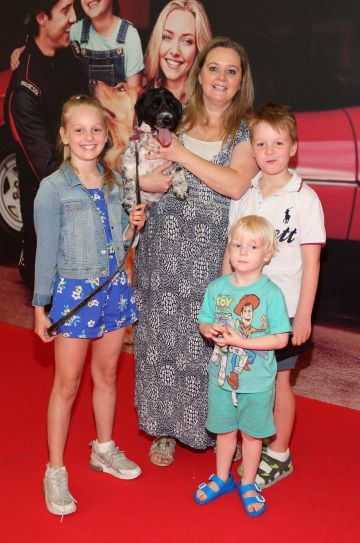 Millie Murray, Michelle Murray, Zac Murray and Cooper Murray with Barney  at the special preview screening of The Art of Racing in the Rain at the Odeon Cinema in Point Square,Dublin . Pic Brian McEvoy Photography