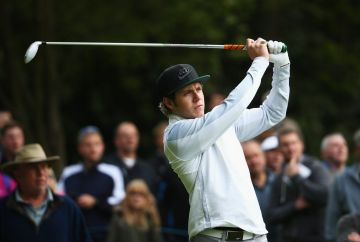 VIRGINIA WATER, ENGLAND - MAY 20:  Niall Horan of One Direction hits a shot during the Pro-Am ahead of the BMW PGA Championship at Wentworth on May 20, 2015 in Virginia Water, England.  (Photo by Ian Walton/Getty Images)