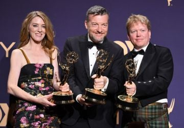"Annabel Jones (L), Charlie Brooker (C) and Russell McLean (R) pose with the Emmy for Outstanding Television Movie ""Bandersnatch"" during the 71st Emmy Awards at the Microsoft Theatre in Los Angeles on September 22, 2019. (Photo by Robyn Beck/Getty Images)"