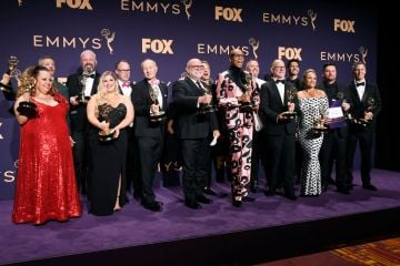 RuPaul (C) and the team behind RuPaul's Drag Race pose with awards for Outstanding Competition Program in the press room during the 71st Emmy Awards at Microsoft Theater on September 22, 2019 in Los Angeles, California. (Photo by Frazer Harrison/Getty Images)