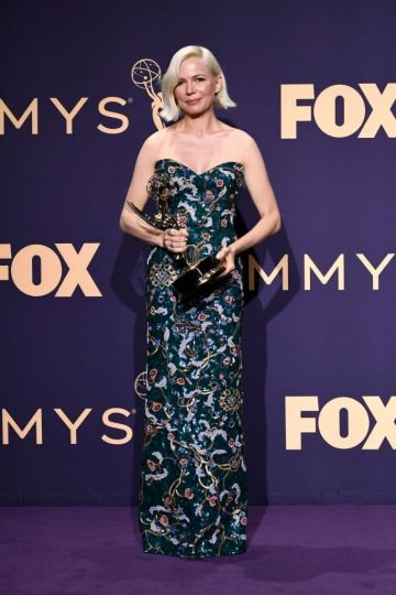 Michelle Williams poses with awards for Outstanding Lead Actress in a Limited Series or Moviein the press room during the 71st Emmy Awards at Microsoft Theater on September 22, 2019 in Los Angeles, California. (Photo by Frazer Harrison/Getty Images)