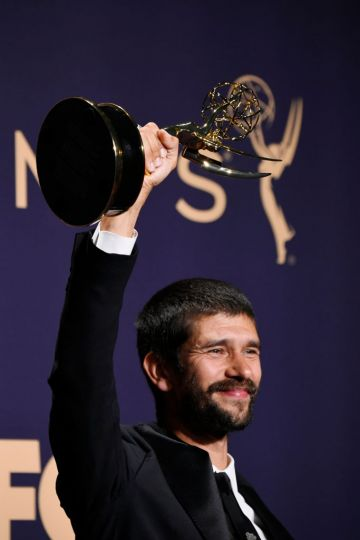 Ben Whishaw poses with award for Outstanding Supporting Actor in a Limited Series or Movie in the press room during the 71st Emmy Awards at Microsoft Theater on September 22, 2019 in Los Angeles, California. (Photo by Frazer Harrison/Getty Images)
