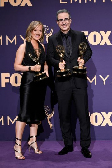 Liz Stanton (L) and John Oliver pose with awards for Outstanding Variety Talk Series in the press room during the 71st Emmy Awards at Microsoft Theater on September 22, 2019 in Los Angeles, California. (Photo by Frazer Harrison/Getty Images)