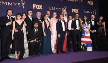 "Maisie Williams, Isaac Hempstead Wright, Emilia Clarke, Peter Dinklage, Sophie Turner, Gwendoline Christie and cast pose with the Emmy for Outstanding Drama Series ""Game Of Thrones"" during the 71st Emmy Awards at the Microsoft Theatre in Los Angeles on September 22, 2019. (Photo by Robyn Beck/Getty Images)"