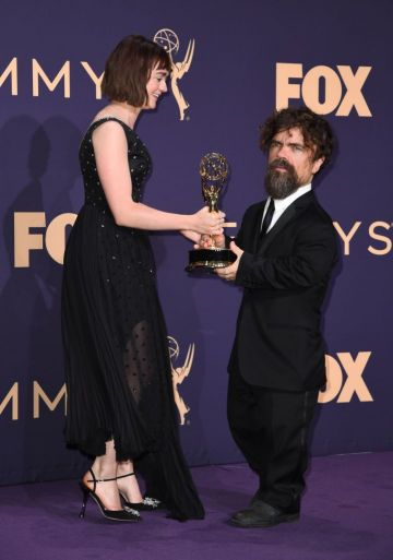 "British actress Maisie Williams and US actor Peter Dinklage pose with the Emmy for Outstanding Drama Series ""Game Of Thrones"" during the 71st Emmy Awards at the Microsoft Theatre in Los Angeles on September 22, 2019. (Photo by Robyn Beck/Getty Images)"
