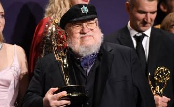 "US novelist George R. R. Martin poses with the Emmy for Outstanding Drama Series ""Game Of Thrones"" during the 71st Emmy Awards at the Microsoft Theatre in Los Angeles on September 22, 2019. (Photo by Robyn Beck/Getty Images)"