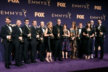 Cast and crew of 'Last Week Tonight with John Oliver' pose with awards for Outstanding Variety Talk Series in the press room during the 71st Emmy Awards at Microsoft Theater on September 22, 2019 in Los Angeles, California. (Photo by Frazer Harrison/Getty Images)