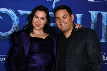 """Songwriters Kristen Anderson-Lopez (L) and Robert Lopez arrive for Disney's World Premiere of """"Frozen 2"""" at the Dolby theatre in Hollywood on November 7, 2019. (Photo by VALERIE MACON/AFP via Getty Images)"""