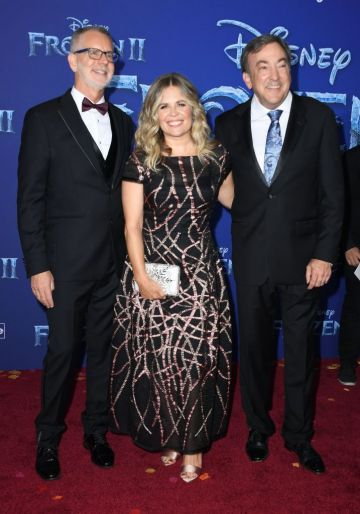 """(L-R) Director Chris Buck, writer Jennifer Lee and producer Peter Del Vecho arrive for Disney's World Premiere of """"Frozen 2"""" at the Dolby theatre in Hollywood on November 7, 2019.  (Photo by VALERIE MACON/AFP via Getty Images)"""