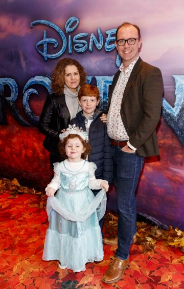 "Brian Redmond with wife Jen Anna (4) and Alex (10) pictured at the special preview screening of Disney's ""Frozen 2"" at the Light House Cinema, Dublin.  Picture Andres Poveda"