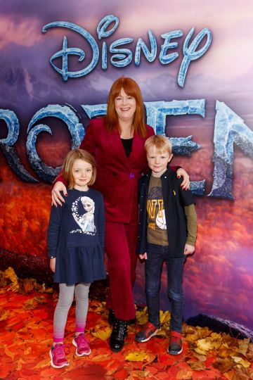 "Blathnaid Ni Chafaigh with Eithne (6) and Eamonn Sheahan (8) pictured at the special preview screening of Disney's ""Frozen 2"" at the Light House Cinema, Dublin.  Picture Andres Poveda"