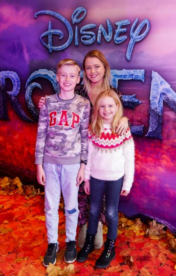 "Helen Curran with Conor (11) and Ella (9) pictured at the special preview screening of Disney's ""Frozen 2"" at the Light House Cinema, Dublin.  Picture Andres Poveda"