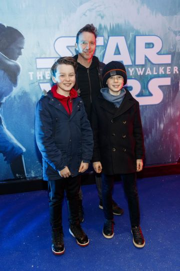 Dermot Whelan and sons Owen (13) and Mathew (12) pictured at the Irish premiere screening of Star Wars: The Rise of Skywalker at Cineworld, Dublin. Picture: Andres Poveda