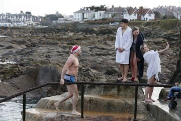 25/12/2019. Forty Foot Xmas Swim. Hundreds of people turned up at the Fortyfoot bathing spot in Sandycove, for the annual Xmas Day swim. Photo:RollingNews.ie