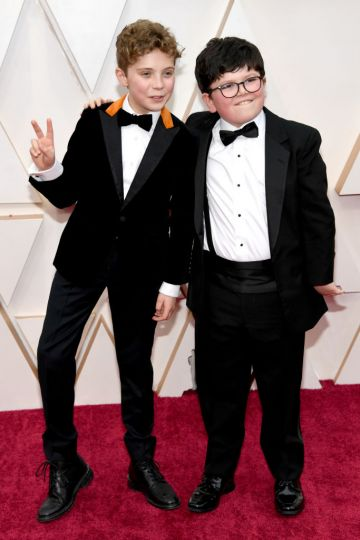 Roman Griffin Davis and Archie Yates attend the 92nd Annual Academy Awards at Hollywood and Highland on February 09, 2020 in Hollywood, California. (Photo by Kevin Mazur/Getty Images)