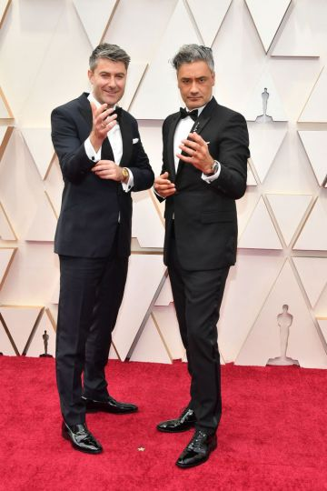Producer Carthew Neal and filmmaker Taika Waititi attend the 92nd Annual Academy Awards at Hollywood and Highland on February 09, 2020 in Hollywood, California. (Photo by Amy Sussman/Getty Images)
