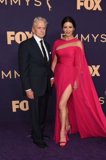 Welsh actress Catherine Zeta-Jones (R) and husband US actor Michael Douglas arrive for the 71st Emmy Awards at the Microsoft Theatre in Los Angeles on September 22, 2019. (Photo by Robyn Beck /Getty Images)