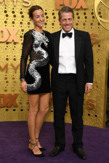 British actress Hugh Grant (R) and wife Anna Elisabet Eberstein arrive for the 71st Emmy Awards at the Microsoft Theatre in Los Angeles on September 22, 2019. (Photo by VALERIE MACON/Getty Images)