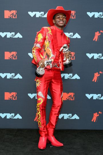 Lil Nas X poses with awards in the Press Room during the 2019 MTV Video Music Awards at Prudential Center on August 26, 2019 in Newark, New Jersey. (Photo by Roy Rochlin/Getty Images for MTV)