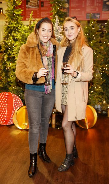 Sorcha and Niamh O'Connor pictured at the M&S Christmas Market inspired press show in the M&S Rooftop Café,  Grafton Street to celebrate the M&S Christmas food collection. Picture: Andres Poveda