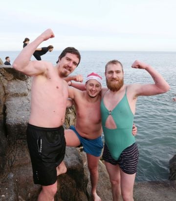 25/12/2019. Forty Foot Xmas Swim. Hundreds of people turned up at the Fortyfoot bathing spot in Sandycove, for the annual Xmas Day swim. Pictured are (LtoR) Paddy Ryan from Saggart, Philip Byrne from Loughlinstown and Robbie Dingle from Jobstown at the Forty Foot Xmas Swim. Photo:RollingNews.ie