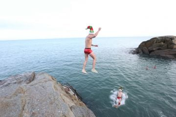 25/12/2019. Forty Foot Xmas Swim. Hundreds of people turned up at the Fortyfoot bathing spot in Sandycove, for the annual Xmas Day swim. Pictured are brothers Dean and Ryan Byrne from Newbridge at the Forty Foot Xmas Swim. Photo:RollingNews.ie