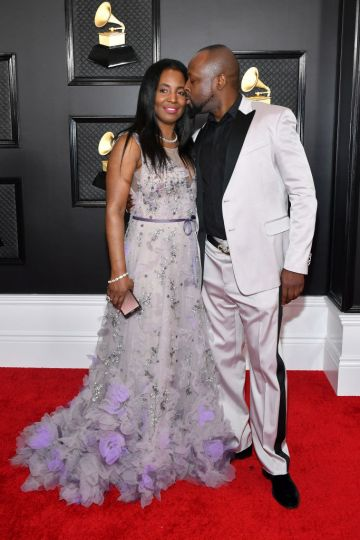 Claudinette Jean and Wyclef Jean (R) attend the 62nd Annual GRAMMY Awards at Staples Center on January 26, 2020 in Los Angeles, California. (Photo by Amy Sussman/Getty Images)