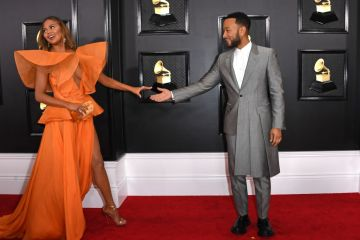 US model Chrissy Teigen (R) and US musician John Legend arrive for the 62nd Annual Grammy Awards on January 26, 2020, in Los Angeles. (Photo by VALERIE MACON / AFP) (Photo by VALERIE MACON/AFP via Getty Images)