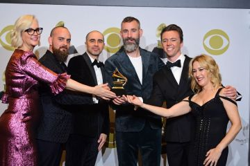 """US songwriter Nick Monson (3rd L), composer Mark Nilan Jr. (2nd R) and DJ White Shadow (C) pose in the press room with the award for for Best Compilation Soundtrack For Visual Media for """"A Star is Born"""" during the 62nd Annual Grammy Awards on January 26, 2020, in Los Angeles. (Photo by FREDERIC J. BROWN / AFP) (Photo by FREDERIC J. BROWN/AFP via Getty Images)"""