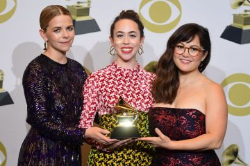 """(From L) Aoife O'Donovan, Sarah Jarosz and Sara Watkins of Im With Her, pose in the press room with the award for Best American Roots Song for """"Call My Name"""" during the 62nd Annual Grammy Awards on January 26, 2020, in Los Angeles. (Photo by FREDERIC J. BROWN / AFP) (Photo by FREDERIC J. BROWN/AFP via Getty Images)"""