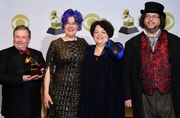 """(From L) Victor Ledin, Nadia Shpachenko, Marina A. Ledin and Barry Werger-Gottesman pose with the award for Best Classical Compendium for """"The Poetry of Places"""" in the press room during the 62nd Annual Grammy Awards on January 26, 2020, in Los Angeles. (Photo by FREDERIC J. BROWN / AFP) (Photo by FREDERIC J. BROWN/AFP via Getty Images)"""
