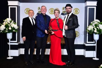 """(From L) Chuck Israels, Craig Terry, Joyce DiDonato and Charlie Porter pose with the award for Best Classical Solo Vocal Album for """"Songplay""""  in the press room during the 62nd Annual Grammy Awards on January 26, 2020, in Los Angeles. (Photo by Frederic J. Brown / AFP) (Photo by FREDERIC J. BROWN/AFP via Getty Images)"""