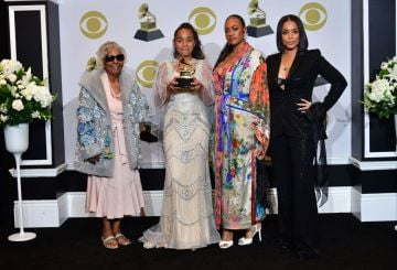 (L-R) Nipsey Hussle's grand mother Margaret Bouffe, Nipsey Hussle's daughter Emani Asghedom, Nipsey Hussle's sister Samantha Smith and Nipsey Hussle's wife Lauren London pose with the Grammy for Best Rap Song Performance in the press room during the 62nd Annual Grammy Awards on January 26, 2020, in Los Angeles. (Photo by Frederic J. Brown / AFP) (Photo by FREDERIC J. BROWN/AFP via Getty Images)