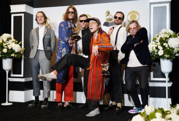 """Cage The Elephant poses in the press room with the award for Best Rock Album for """"Social Cues""""  during the 62nd Annual GRAMMY Awards at Staples Center on January 26, 2020 in Los Angeles, California. (Photo by Rachel Luna/FilmMagic)"""