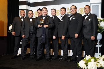 """Mariachi Los Camperos ensemble pose in the press room with the award for Best Regional Mexican Music Album for """"De Ayer Para Siempre"""" during the 62nd Annual GRAMMY Awards at Staples Center on January 26, 2020 in Los Angeles, California. (Photo by Rachel Luna/FilmMagic)"""