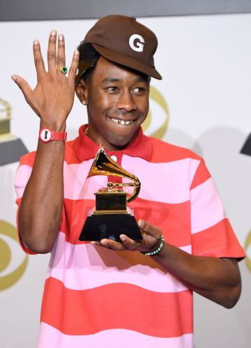 """Tyler the Creator poses in the press room with the award for Best Rap Album for """"Igor"""" during the 62nd Annual GRAMMY Awards at Staples Center on January 26, 2020 in Los Angeles, California. (Photo by Steve Granitz/WireImage)"""