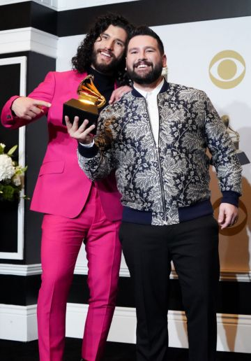 """(L-R) Dan Smyers and Shay Mooney of Dan + Shay, winner of Best Country Duo/Group Performance for """"Speechless"""" pose in the press room during the 62nd Annual GRAMMY Awards at Staples Center on January 26, 2020 in Los Angeles, California. (Photo by Rachel Luna/FilmMagic)"""