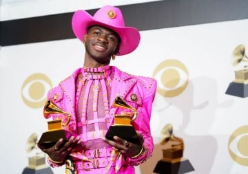 Lil Nas X poses in the press room with the awards for Best Music Video and Best Pop Duo/Group Performance during the 62nd Annual GRAMMY Awards at Staples Center on January 26, 2020 in Los Angeles, California. (Photo by Rachel Luna/FilmMagic)