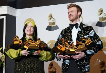 """(L-R) Billie Eilish, winner of Record of the Year for """"Bad Guy"""", Album of the Year for """"when we all fall asleep, where do we go?"""", Song of the Year for """"Bad Guy"""", Best New Artist and Best Pop Vocal Album for """"when we all fall asleep, where do we go?"""", and Finneas O'Connell, winner of Best Engineered Album Non-Classical for """"when we all fall asleep, where do we go?"""", Song of the Year for """"Bad Guy"""", and Producer Of The Year Non-Classical pose in the press room during the 62nd Annual GRAMMY Awards at Staples Center on January 26, 2020 in Los Angeles, California. (Photo by Rachel Luna/FilmMagic)"""